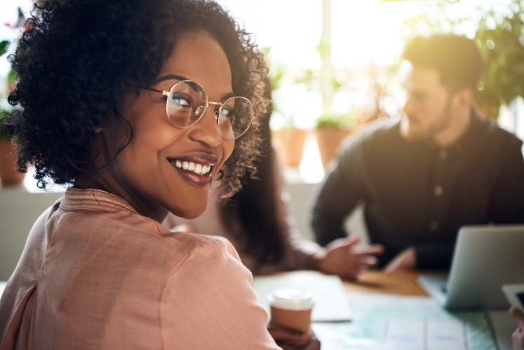 African businesswoman smiling during a boardoom meeting in an office
